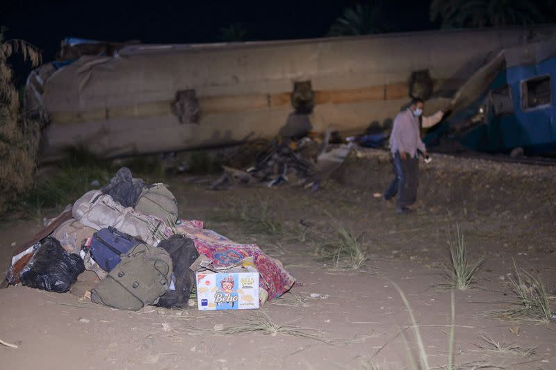 Belongings are seen near the site where two trains have collided near the city of Sohag
