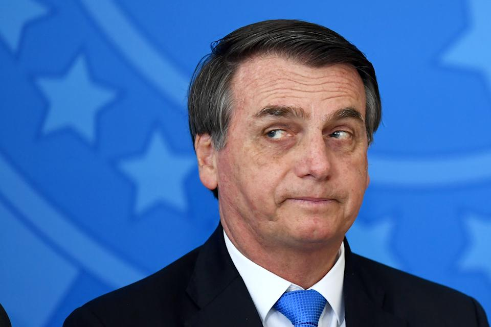 """Brazilian President Jair Bolsonaro is pictured during the commemoration ceremony of the National Volunteer Day, at Planalto Palace in Brasilia, on August 28, 2019. - Bolsonaro on Wednesday repeated a demand for French leader Emmanuel Macron to withdraw recent remarks, as he accused France and Germany of """"buying"""" the Latin American country's sovereignty with Amazon fire aid. Bolsonaro's comments come a day after he said he was open to discussing the G7's offer of $20 million to help combat fires raging in the world's largest rainforest, but only if the French leader retracted his """"insults"""" against him. (Photo by EVARISTO SA / AFP)        (Photo credit should read EVARISTO SA/AFP via Getty Images)"""