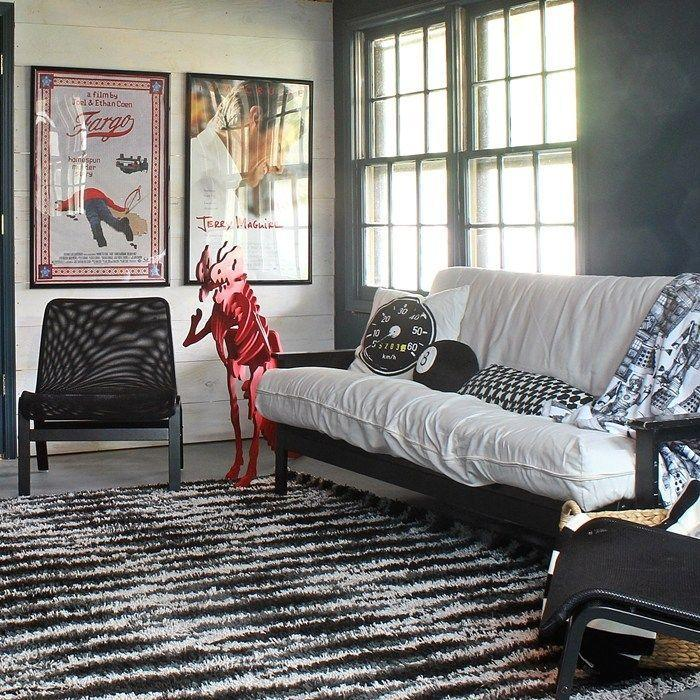 """<p>This basement movie room is perfect for cinephiles and couch potatoes alike. Add a playful touch like a red dinosaur statue to make this room fun for the whole family.</p><p><strong>See more at <a href=""""https://boxycolonial.com/basement-movie-game-room-fall-love/"""" rel=""""nofollow noopener"""" target=""""_blank"""" data-ylk=""""slk:Boxy Colonial"""" class=""""link rapid-noclick-resp"""">Boxy Colonial</a>.</strong></p><p><a class=""""link rapid-noclick-resp"""" href=""""https://go.redirectingat.com?id=74968X1596630&url=https%3A%2F%2Fwww.walmart.com%2Fip%2FBack-to-The-Future-Official-Movie-Poster-24-by-36-Inches%2F812941385&sref=https%3A%2F%2Fwww.redbookmag.com%2Fhome%2Fg36061437%2Fbasement-ideas%2F"""" rel=""""nofollow noopener"""" target=""""_blank"""" data-ylk=""""slk:SHOP MOVIE POSTERS"""">SHOP MOVIE POSTERS</a></p>"""