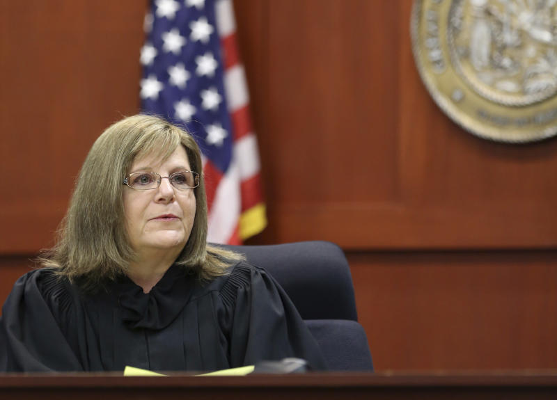 FILE - In a Tuesday, July 2, 2013 file pool photo, Judge Debra Nelson instructs the jury at the George Zimmerman trial in Seminole circuit court, in Sanford, Fla. After presenting more than three dozen witnesses over two weeks, prosecutors rested their case on Friday.As is typical after the prosecution rests, the defense asked Judge Nelson to acquit Zimmerman, claiming prosecutors' didn't prove their case. The judge denied the request. (AP Photo/Orlando Sentinel, Joe Burbank, Pool, File)