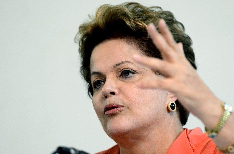 Brazilian President Dilma Rousseff gestures during a press conference at Granja do Torto presidential residence, following a cabinet meeting in Brasilia on July 1, 2013. Brazil's Congress has received a request from President Dilma Rousseff to hold a referendum on political reform in response to the worst social unrest in 20 years