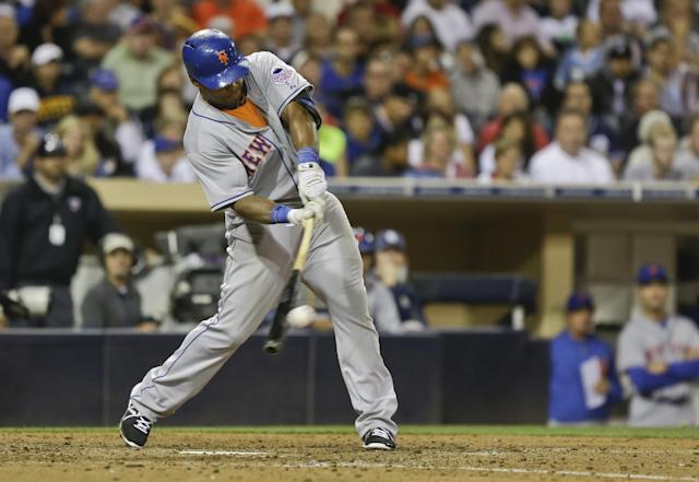 New York Mets' Marlon Byrd laces double to right field and drives in two runs against the San Diego Padres in the eighth inning of a baseball game Thursday, Aug. 15, 2013, in San Diego. (AP Photo/Lenny Ignelzi)