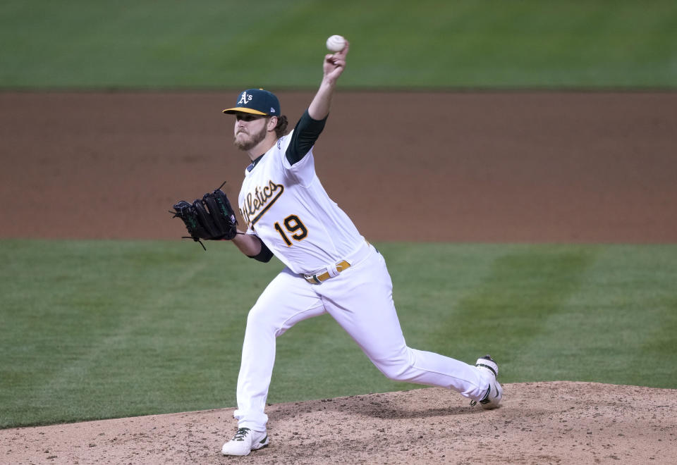 OAKLAND, CALIFORNIA - MAY 04: Cole Irvin #19 of the Oakland Athletics pitches against the Toronto Blue Jays in the seventh inning at RingCentral Coliseum on May 04, 2021 in Oakland, California. (Photo by Thearon W. Henderson/Getty Images)