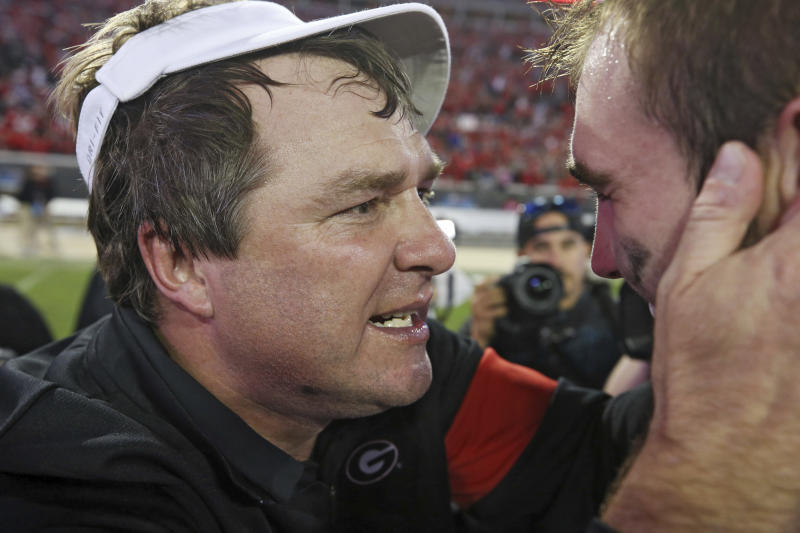 Georgia coach Kirby Smart, left, congratulates quarterback Jake Fromm after the team's 24-17 win over Florida in an NCAA college football game Saturday, Nov. 2, 2019, in Jacksonville, Fla. (Bob Andres/Atlanta Journal Constitution via AP)