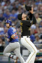 Chicago Cubs' Jonathan Lucroy (25) looks back as Pittsburgh Pirates starting pitcher Joe Musgrove looks to catch his pop fly for an out in the fifth inning of a baseball game, Friday, Aug. 16, 2019, in Pittsburgh. (AP Photo/Keith Srakocic)
