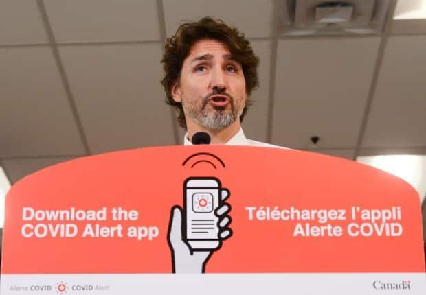 Prime Minister Justin Trudeau has been one of the most prominent supporters of the COVID Alert app and frequently promotes its use during televised pandemic updates. (Sean Kilpatrick/The Canadian Press - image credit)