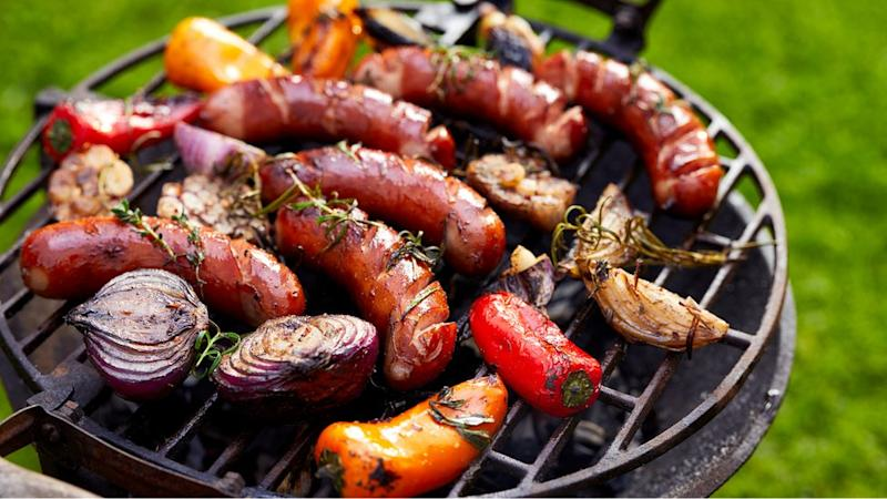 Grilled sausages and vegetables on a grilled plate