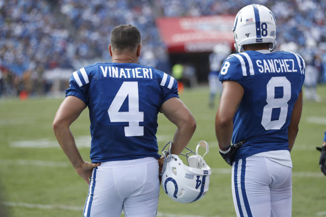 Indianapolis Colts kicker Adam Vinatieri (4) stands on the sideline with holder Rigoberto Sanchez (8) after Vinatieri missed his second extra point of the game against the Tennessee Titans in the second half of an NFL football game Sunday, Sept. 15, 2019, in Nashville, Tenn. (AP Photo/Wade Payne)