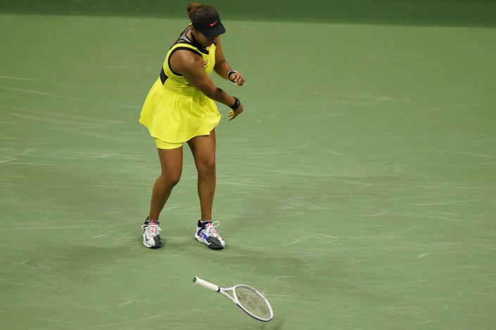 Naomi Osaka, of Japan, throws her racket down during a match against Leylah Fernandez, of Canada, at the third round of the US Open tennis championships, Friday, Sept. 3, 2021, in New York. (AP Photo/Frank Franklin II)