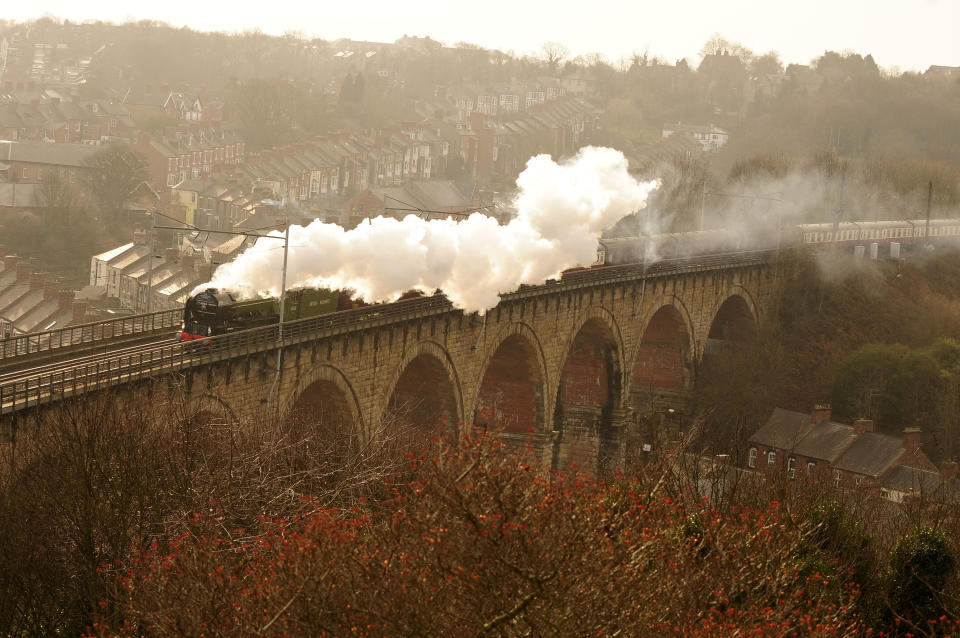 The Tornado Steam Locomotive is seen carrying her first passengers through Durham, northern England January 31, 2009.  The last of the Peppercorn class 'A1' steam  locomotives was scrapped in 1966, but this new locomotive, number 60163 Tornado, and built by the A1 Steam Locomotive Trust in Darlington, pulled her first passengers on the Network Rail main line from York to Newcastle-upon-Tyne on Saturday.         REUTERS/Nigel Roddis    (BRITAIN)