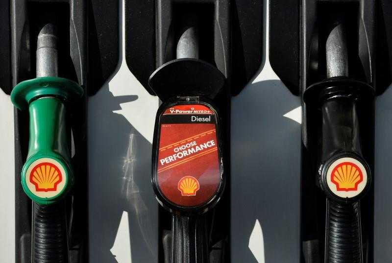 Shell logos are seen on fuel pumps at a petrol station in west London