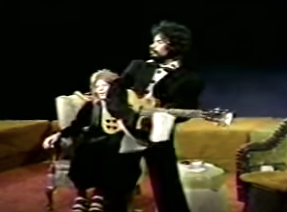 John Oates puts n his penguin jacket for his