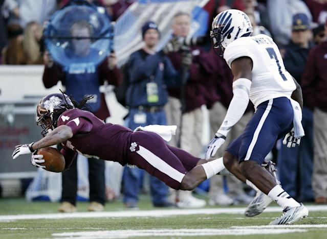 Mississippi State wide receiver Jameon Lewis (4) is knocked down by Rice safety Julius White (7) as Lewis gains 28 yards on a pass in the first quarter of the Liberty Bowl NCAA college football game on Tuesday, Dec. 31, 2013, in Memphis, Tenn. (AP Photo/Mark Humphrey)