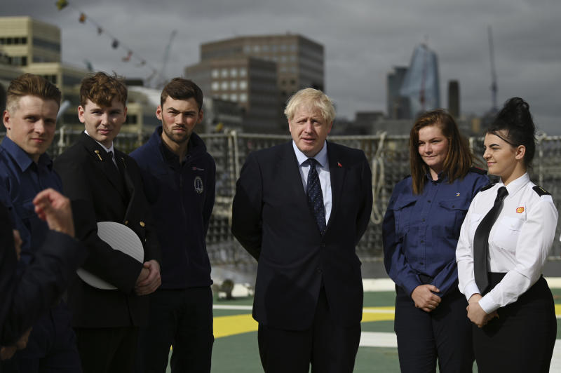 Britain's Prime Minister Boris Johnson speaks to apprentices as he visits the NLV Pharos, a lighthouse tender moored on the river Thames, to mark London International Shipping Week in London, Thursday, Sept. 12, 2019. The British government insisted Thursday that its forecast of food and medicine shortages, gridlock at ports and riots in the streets after a no-deal Brexit is an avoidable worst-case scenario, as Prime Minister Boris Johnson denied misleading Queen Elizabeth II about his reasons for suspending Parliament just weeks before the country is due to leave the European Union. (Daniel Leal-Olivas/Pool photo via AP)