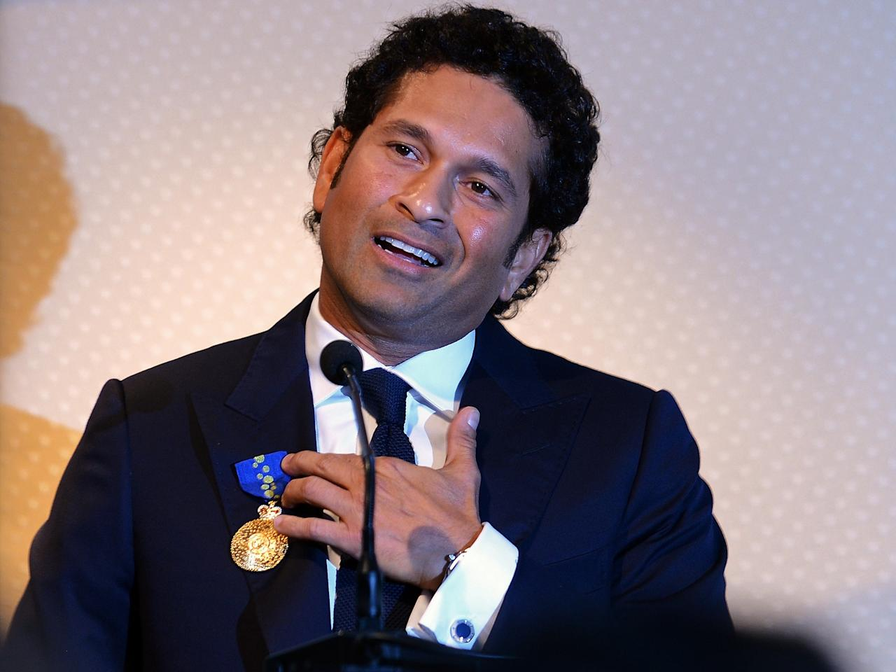 "Indian cricketer Sachin Tendulkar speaks after being conferred with the membership of The Order of Australia by Simon Crean, Australian Minister for Regional Australia, Regional Development and Local Government, during a ceremony in Mumbai on November 6, 2012. India's record-breaking batsman Sachin Tendulkar on November 6 was conferred with membership of the Order of Australia. Australian Prime Minister Julia Gillard, who announced Tendulkar's membership to the Order during a three-day state visit to India last month, told reporters that Tendulkar deserved the ""special honour"" because he was a ""very special cricketer"". AFP PHOTO/ INDRANIL MUKHERJEE"