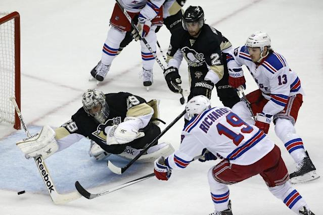 New York Rangers' Brad Richards (19) fires the puck past Pittsburgh Penguins goalie Marc-Andre Fleury (29) for a goal in the first period of Game 1 of a second-round NHL hockey playoff series in Pittsburgh, Friday, May 2, 2014. (AP Photo/Gene J. Puskar)
