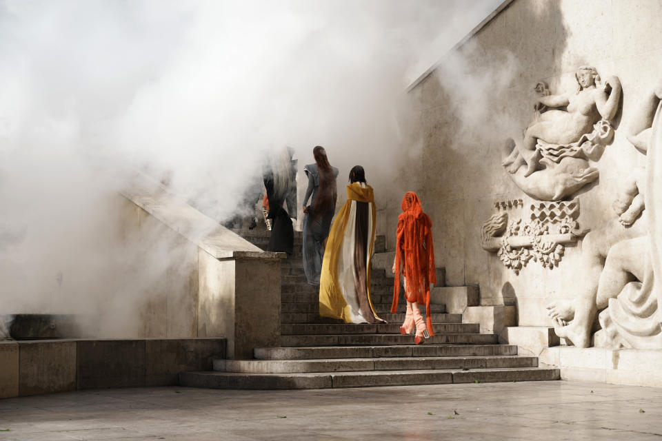 Models wear creations for Rick Owens' Spring-Summer 2022 ready-to-wear fashion show presented Thursday, Sept. 30, 2021, in Paris. (AP Photo/Thibault Camus)