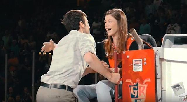 An intrepid zamboni driver pops the question during intermission in Game 5 of the AHL's Western Conference final. (Photo: YouTube)