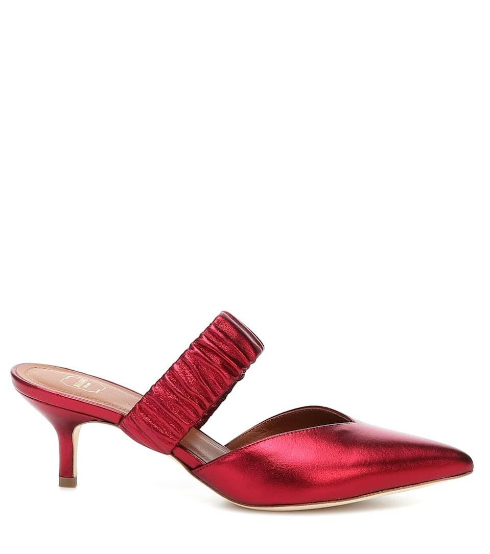 "<p>Shoes, £475, Malone Souliers at MyTheresa.com</p><p><a class=""link rapid-noclick-resp"" href=""https://go.redirectingat.com?id=127X1599956&url=https%3A%2F%2Fwww.mytheresa.com%2Fen-gb%2Fmalone-souliers-matilda-45-metallic-leather-mules-1402078.html%3Fcatref%3Dcategory&sref=https%3A%2F%2Fwww.townandcountrymag.com%2Fuk%2Fstyle%2Ffashion%2Fg32741166%2Fstyle-icon-lupita-nyongo%2F"" rel=""nofollow noopener"" target=""_blank"" data-ylk=""slk:SHOP NOW"">SHOP NOW</a></p>"