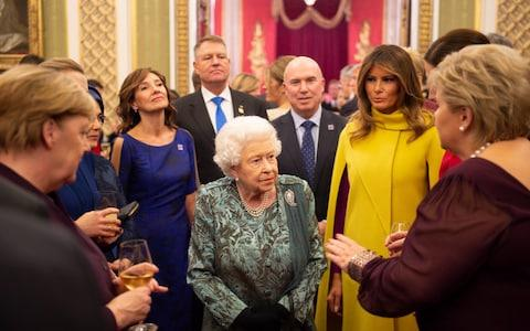 The Queen speaks with Mrs Merkel, Mrs Trump and others during the Nato reception - Credit: Geoff Pugh for The Telegraph