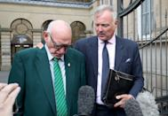 Former TV presenter John Leslie leaves Edinburgh Sheriff Court, with his father Lesley Stott (left), after being acquitted of sexually assaulting a woman in an Edinburgh nightclub.