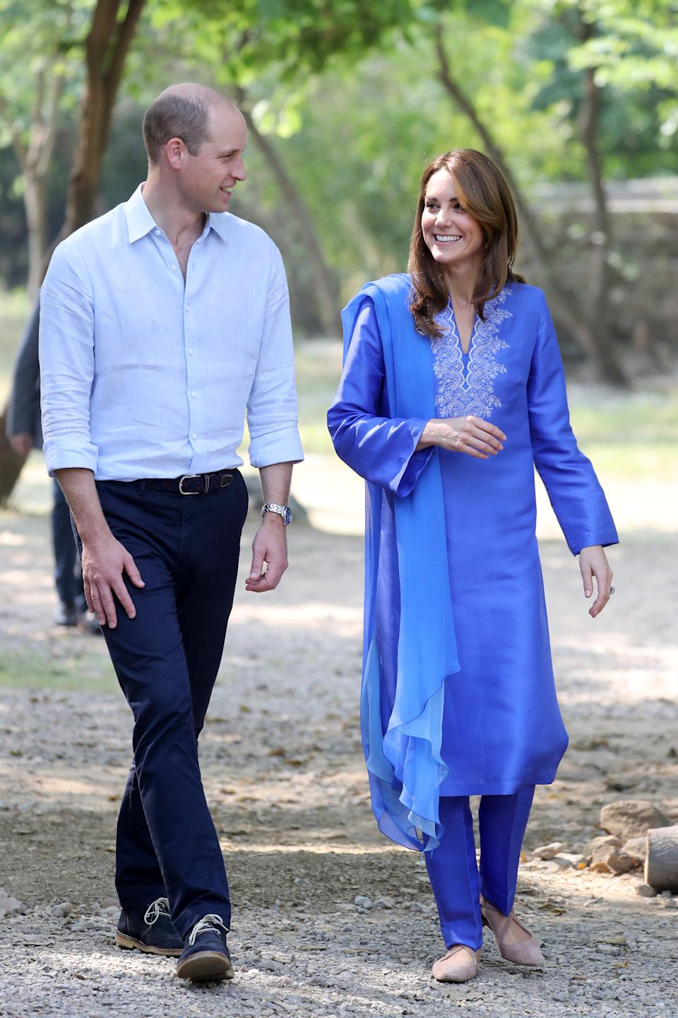 The Duchess of Cambridge then changed into a pair of Russell & Bromley flats to visit Margallah Hills National Park. [Photo: Getty]