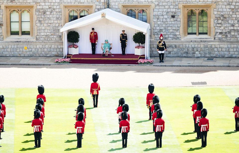 <p>Queen Elizabeth sat on a podium to watch the military drills, and The Welsh Guards remained socially distanced from one another.</p>