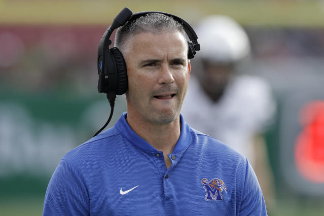 Memphis head coach Mike Norvell watches the action against South Florida during the first half of an NCAA college football game Saturday, Nov. 23, 2019, in Tampa, Fla. (AP Photo/Chris O'Meara)