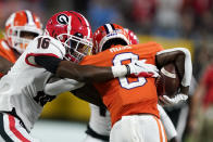 Clemson wide receiver Justyn Ross is tackled by Georgia defensive back Lewis Cine (16) during the first half of an NCAA college football game Saturday, Sept. 4, 2021, in Charlotte, N.C. (AP Photo/Chris Carlson)