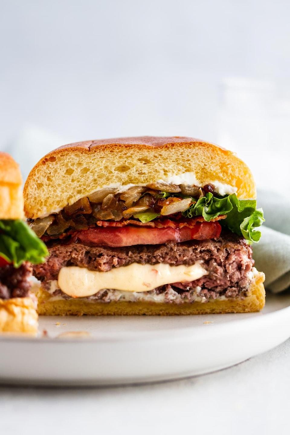 "<p>Good meat is easy to find in Missouri, meaning this over-the-top burger recipe is about to get even better. It puts thick-cut Pepper Jack cheese <em>inside</em> the burger patties so the finished product is oozing with rich flavors.</p> <p><strong>Get the recipe</strong>: <a href=""https://www.girlversusdough.com/pepper-jack-juicy-lucy/"" class=""link rapid-noclick-resp"" rel=""nofollow noopener"" target=""_blank"" data-ylk=""slk:pepper jack juicy lucy hamburger"">pepper jack juicy lucy hamburger</a></p>"