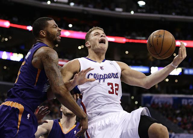 Los Angeles Clippers' Blake Griffin, right, is fouled by Phoenix Suns' Marcus Morris during the first half of an NBA basketball game on Monday, Dec. 30, 2013, in Los Angeles. (AP Photo/Jae C. Hong)
