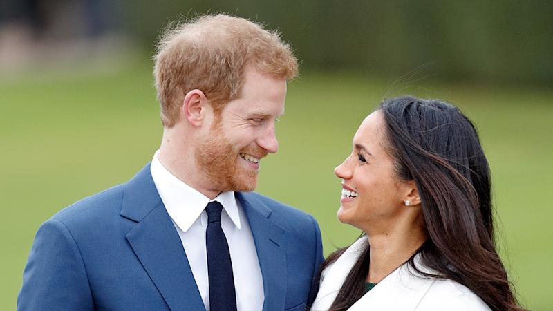 Prince Harry and Meghan Markle make eye contact in their engagement photos