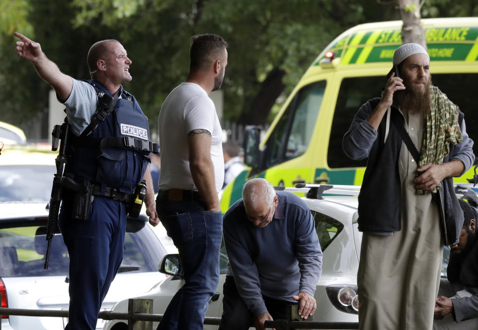 FILE - In this March 15, 2019, file photo, police attempt to clear people from outside a mosque in central Christchurch, New Zealand. Tentative plans for a movie that recounts the response of New Zealand Prime Minister Jacinda Ardern to a gunman's slaughter of Muslim worshippers drew criticism in New Zealand on Friday, June 11, 2021 for not focusing on the victims of the attacks. (AP Photo/Mark Baker, File)