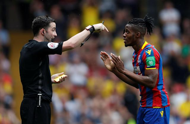 """Soccer Football - Premier League - Watford v Crystal Palace - Vicarage Road, Watford, Britain - April 21, 2018 Crystal Palace's Wilfried Zaha reacts after being shown a yellow card by referee Chris Kavanagh for simulation Action Images via Reuters/Paul Childs EDITORIAL USE ONLY. No use with unauthorized audio, video, data, fixture lists, club/league logos or """"live"""" services. Online in-match use limited to 75 images, no video emulation. No use in betting, games or single club/league/player publications. Please contact your account representative for further details."""