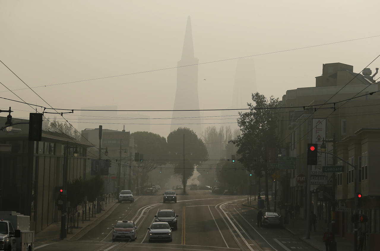 The Transamerica Pyramid is obscured by smoke and haze from wildfires Friday, Nov. 16, 2018, in San Francisco. (AP Photo/Eric Risberg)