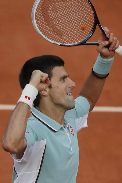 Serbia's Novak Djokovic celebrates defeating Bulgaria's Grigor Dimitrov in three sets in their third round match at the French Open tennis tournament, at Roland Garros stadium in Paris, Saturday, June 1, 2013. (AP Photo/Michel Spingler)