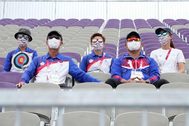 PHOTO: People sitting on the athletes' stand watch watch the men's team competition at the 2020 Summer Olympics, Monday, July 26, 2021, in Tokyo, Japan. (Alessandra Tarantino/AP Photo)