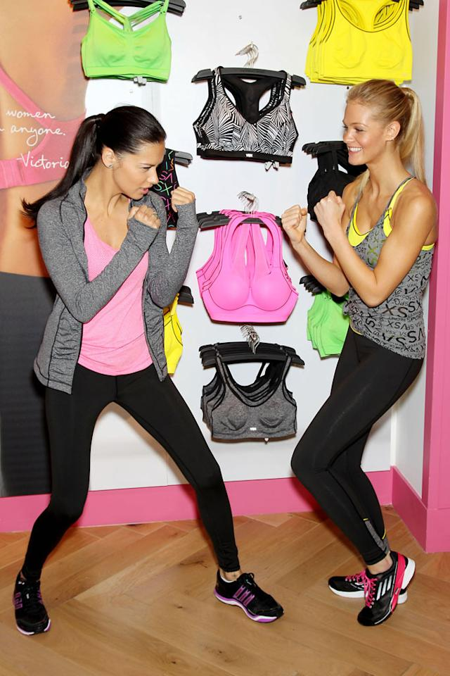 -New York, NY - 01/15/2013 - Victoria's Secret Angels Kick Off a Healthy & Fit New Year with Victoria's Secret Sport -PICTURED: Adriana Lima, Erin Heatherton -PHOTO by: Marion Curtis/Startraksphoto.com -Filename: MC618021 -Location: Victoria's Secret Herald Square Editorial - Rights Managed Image - Please contact www.startraksphoto.com for licensing fee Startraks Photo New York, NY For licensing please call 212-414-9464 or email sales@startraksphoto.com