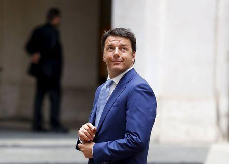 Italian Prime Minister Renzi looks up as he waits for the arrival of Palestinian President Abbas at Chigi Palace in Rome