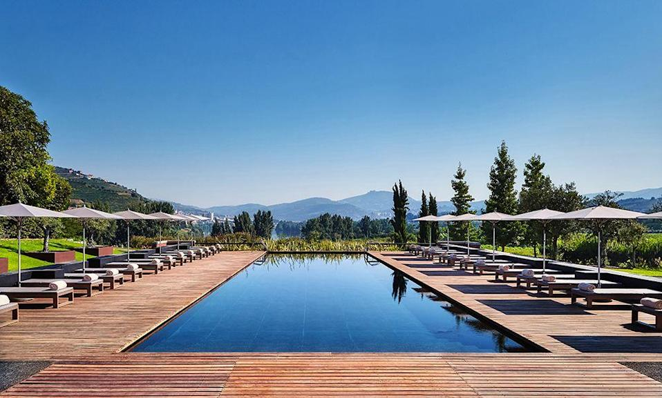 """<p>Beautiful enough to make us weep - imagine diving into this pool straight out of Tier 4? Perched high on a hill in Portugal's enchanting wine country,<a href=""""http://www.sixsenses.com"""" rel=""""nofollow noopener"""" target=""""_blank"""" data-ylk=""""slk:Six Senses resort's"""" class=""""link rapid-noclick-resp""""> Six Senses resort's</a> stunning outdoor pool is heated for year-round dips. Sigh.</p>"""