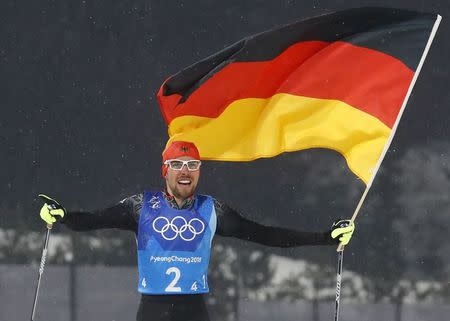 Nordic Combined Events - Pyeongchang 2018 Winter Olympics - Men's Team 4 x 5 km Final - Alpensia Cross-Country Skiing Centre - Pyeongchang, South Korea - February 22, 2018 - Johannes Rydzek of Germany celebrates with the German flag after winning REUTERS/Kai Pfaffenbach