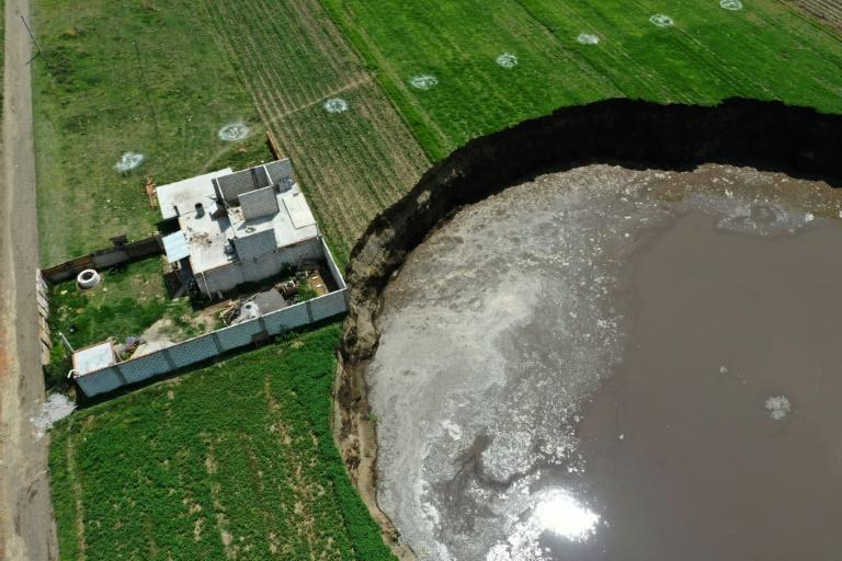 A sinkhole is threatening to swallow a house in the Mexican state of Puebla
