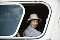 <p>Looking out a window during a royal trip to Acapulco, Mexico, she wears a purple ensemble.<br></p>