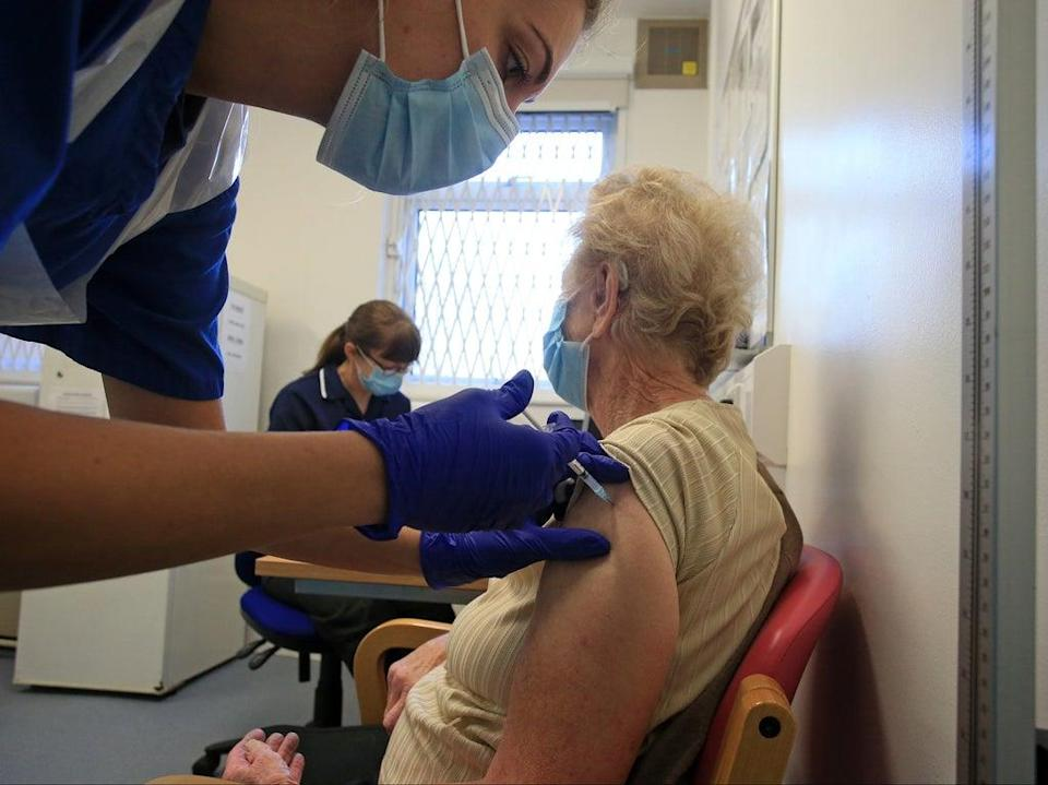 A nurse at a GP practice in Haxby vaccinates an elderly patient  (AFP/Getty)
