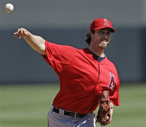 Los Angeles Angels starting pitcher Dan Haren throws to the Arizona Diamondbacks during the first inning of a spring training baseball game, Tuesday, March 13, 2012, in Scottsdale, Ariz. (AP Photo/Marcio Jose Sanchez)