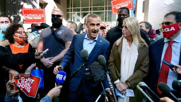 PHOTO: President Donald Trump's campaign advisor Corey Lewandowski, center, speaks about a court order obtained to grant more access to vote counting operations at the Pennsylvania Convention Center, Nov. 5, 2020, in Philadelphia. (Matt Slocum/AP)