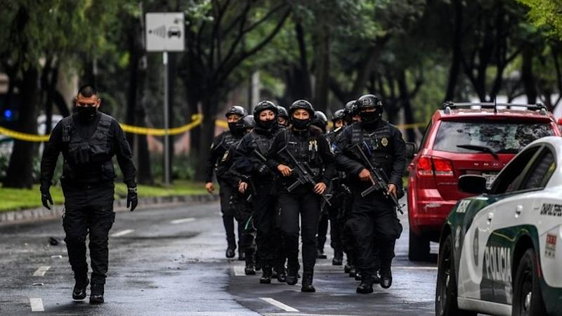 Police officers are deployed after Mexico City's Public Security Secretary Omar Garcia Harfuch was wounded in an attack in Mexico City, on June 26, 2020.