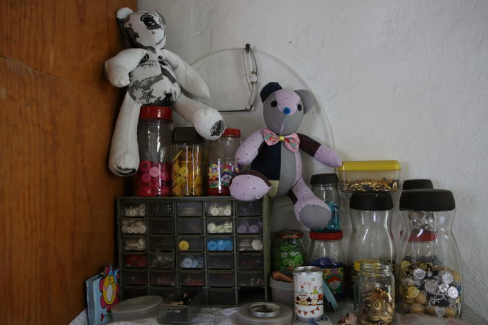 Teddy bears made with pieces of clothing that were worn by COVID-19 victims, sit in the workshop of seamstress Irma de la Parra, in Mexico City, Saturday, April 24, 2021. De la Parra used to make teachers' gowns, but school closings during the pandemic left her without a job. She took it upon herself to make teddy bears out of clothing from those who died of COVID-19 to give those who are still alive a chance to grieve and be closer to those they were unable to bid farewell to. (AP Photo/Ginnette Riquelme)