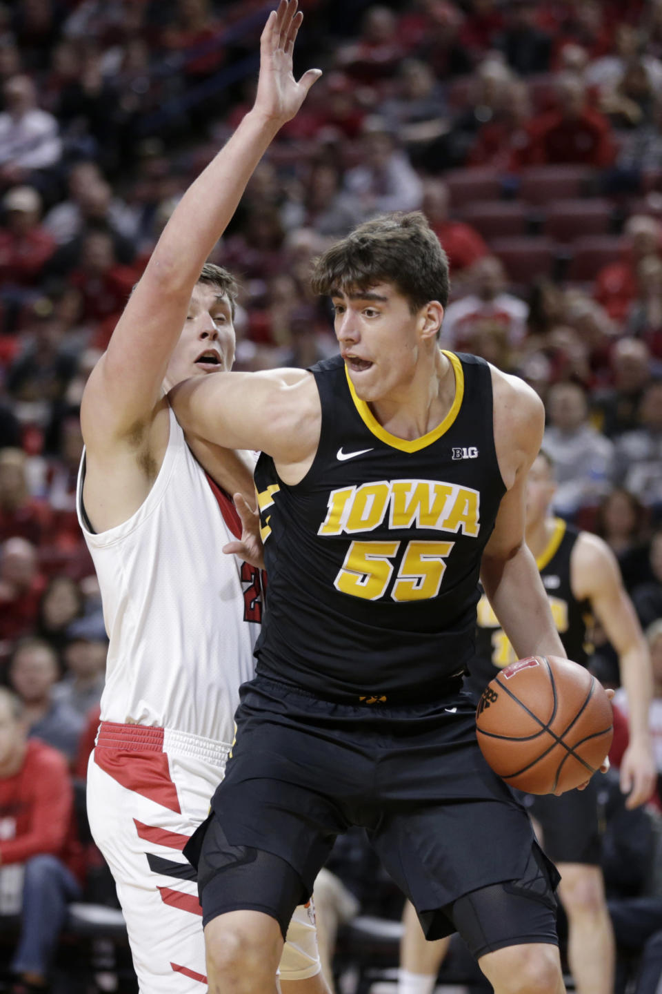 Iowa's Luka Garza (55) is defended by Nebraska's Tanner Borchardt during the first half of an NCAA college basketball game in Lincoln, Neb., Sunday, March 10, 2019. (AP Photo/Nati Harnik)