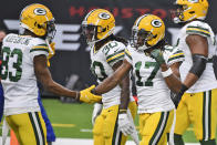 Green Bay Packers wide receiver Davante Adams (17) is congratulated by wide receiver Marquez Valdes-Scantling after scoring during the second half of an NFL football game against the Houston Texans Sunday, Oct. 25, 2020, in Houston. (AP Photo/Eric Christian Smith)